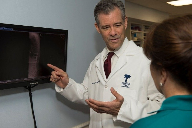 office, Dr. Hepler explains some condition, Orthopedic spine surgeon palm beach county